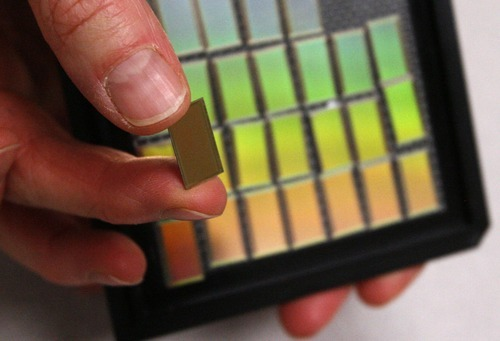 Leah Hogsten  |  Tribune file photo The IM Flash Technologies plant in Lehi, which produces wafer-like chips that hold memory in electronic devices, will continue to operate