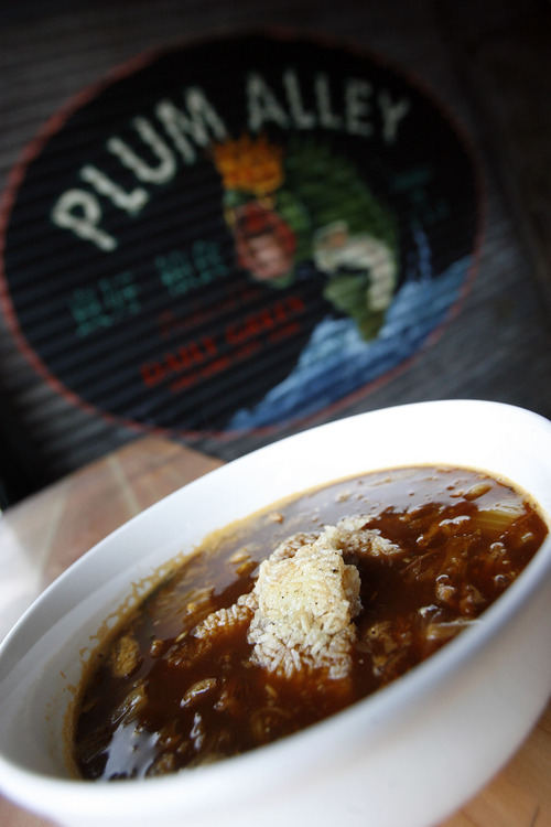 Francisco Kjolseth  |  The Salt Lake Tribune Kimchi, a fermented cabbage dish from Korea, is known to have health benefits. Plum Alley, at 111 E. 300 South in Salt Lake City, serves up kimchi with a daily selection of pickled vegetables or as the kimchi stew, made with spicy broth, pulled pork and rice cakes that comes with small porcelain bowls to serve communally.