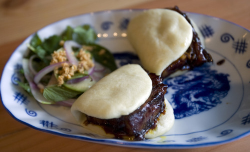 Kim Raff  |  The Salt Lake Tribune Steamed buns with pork belly at Plum Alley in Salt Lake City.