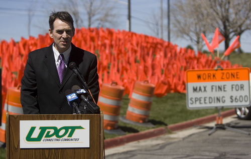 Tribune file photo John Njord, executive director of the Utah Department of Transportation, needed someone to fire after the contract scandal over I-15 construction blew up during the 2010 governor's race, says an attorney for former UDOT civil-rights officer Denice Graham. UDOT disagrees with a ruling finding Graham was improperly fired and should get her old job back. Njord is pictured in here at a 2009 press conference.