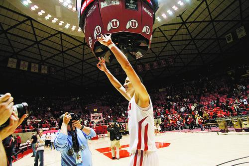 Kim Raff  |  The Salt Lake Tribune University of Utah player Jason Washburn celebrates defeating  Stanford 58-57 at the Huntsman Center in Salt Lake City, Utah on February 25, 2012.