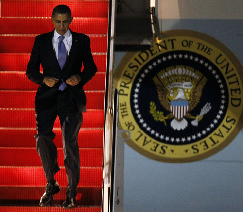 President Barack Obama walks down the steps from Air Force One after arriving at Andrews Air Force Base, Md., Friday, March 2, 2012. (AP Photo/Ann Heisenfelt)