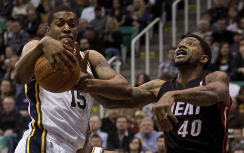 Trent Nelson  |  The Salt Lake Tribune Utah Jazz forward Derrick Favors (15) and Miami's Udonis Haslem (40) reach for a rebound. Utah Jazz vs. Miami Heat, NBA basketball at EnergySolutions Arena Friday, March 2, 2012 in Salt Lake City, Utah.