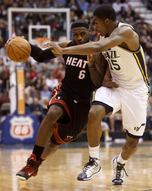 Trent Nelson     The Salt Lake Tribune Miami's LeBron James (6) drives on Utah Jazz forward Derrick Favors (15). Utah Jazz vs. Miami Heat, NBA basketball at EnergySolutions Arena Friday, March 2, 2012 in Salt Lake City, Utah.