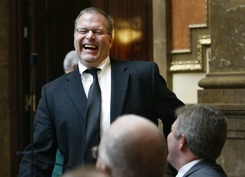 Scott Sommerdorf  |  The Salt Lake Tribune              Sen. Stephen Urquhart, R-St.George, laughs while talking with members of the Utah House on Thursday. His bill, SB170 - Driver License Qualification Amendments - unexpectedly was able to get out of committee to the Senate floor.