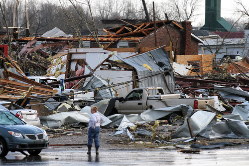 In this photo provided by SWAT Chasers via the Indianapolis Star, structures are left damaged in Henryville, Ind., Friday, March 2, 2012, after a series of powerful tornadoes tore through southern Indiana, killing at least 14 people and leaving several small towns in ruin. At least one person was confirmed dead in hard-hit Henryville. (AP Photo/SWAT Chasers, Chris Bergin via the Indianapolis Star)