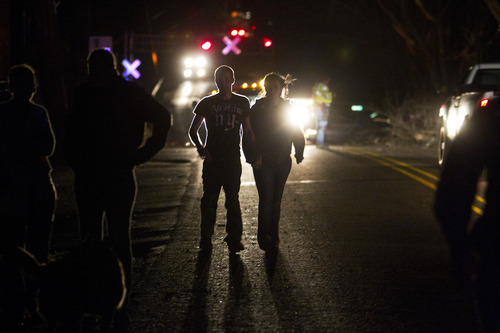 A couple walks along a main road in Henryville, Ind., after a tornado swept through the town on Friday, March 2,  2012. Authorities in Indiana say at least ten people have been killed in violent storms that spawned tornadoes across a wide swath of southern Indiana. (AP Photo/Philip Scott Andrews)