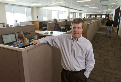 Trent Nelson  |  The Salt Lake Tribune Peter Flanagan, CEO at FLSmidth, in front of an area that was once open space and is now filled with cubicles and new employees. FLSmidth expects to hire 150 people in 2012. The company has outgrown its two new buildings, which were opened in late 2010. The company has started to put employees in conference rooms and is doubling up on cubicles. Friday, March 2, 2012 in Midvale, Utah.