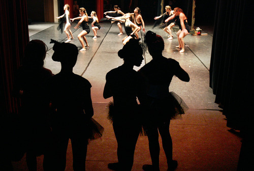 Scott Sommerdorf  |  The Salt Lake Tribune              Dancers backstage wait for their turn to dance during the