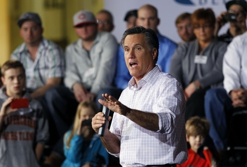 Republican presidential candidate, former Massachusetts Gov. Mitt Romney campaigns at a rally in Dayton, Ohio, Saturday, March 3, 2012. (AP Photo/Gerald Herbert)