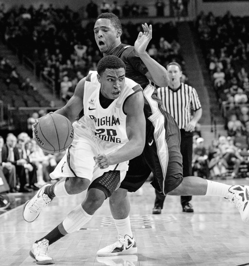 BYU's Anson Winder drives past San Diego's Darian Norris during the first half of an NCAA college basketball game at the West Coast Conference tournament on Friday, March 2, 2012, in Las Vegas. (AP Photo/Isaac Brekken)