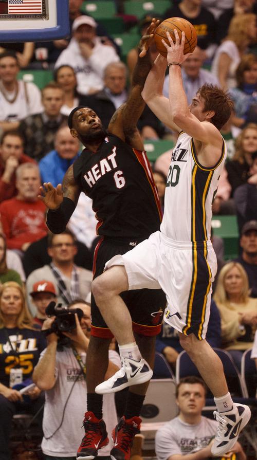 Trent Nelson  |  The Salt Lake Tribune Utah Jazz forward Gordon Hayward (20) shoots, with Miami's LeBron James (6) defending. Utah Jazz vs. Miami Heat, NBA basketball at EnergySolutions Arena Friday, March 2, 2012 in Salt Lake City, Utah.