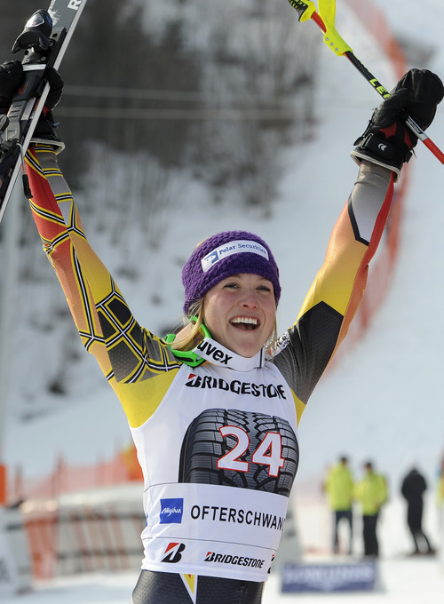 Erin Mielzynski, of Canada, celebrates after winning an alpine ski, women's World Cup slalom, in Ofterschwang, Germany, Sunday, March 4, 2012. Mielzynski of Canada won a slalom Sunday for her first career World Cup victory. (AP Photo/Elvis Piazzi)