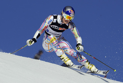Lindsey Vonn of USA speeds down the course during the first run of an alpine ski, women's World Cup giant slalom in Ofterschwang, Germany, Friday, March 2, 2012.  (AP Photo/Elwis Piazzi)