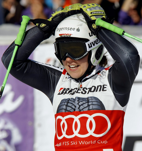Germany's Viktoria Rebensburg celebrates after winning an alpine ski, women's World Cup giant slalom, in Ofterschwang, Germany, Saturday, March 3, 2012. (AP Photo/Armando Trovati)