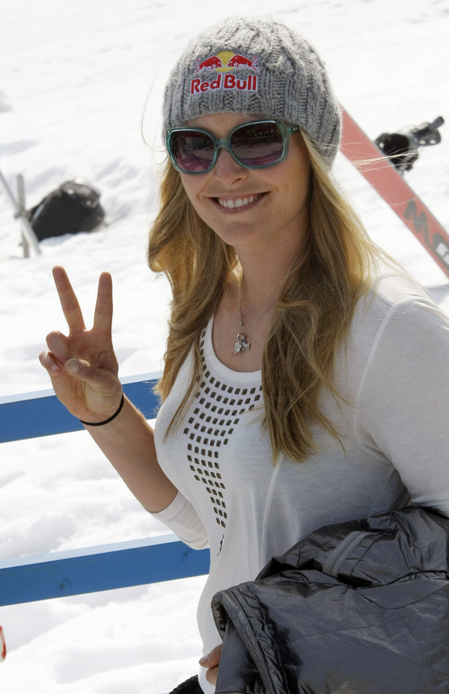 Lindsey Vonn, of the United States, gestures as she stands in the finish area of an alpine ski, women's World Cup slalom, in Ofterschwang, Germany, Sunday, March 4, 2012. (AP Photo/Elvis Piazzi)
