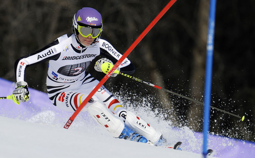 Maria Hoefl-Riesch, of Germany, slaloms past a pole during the first run of an alpine ski, women's World Cup slalom, in Ofterschwang, Germany, Sunday, March 4, 2012. (AP Photo/Elvis Piazzi)