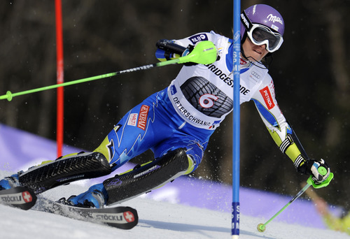 Slovenia's Tina Maze slaloms past a pole during the first run of an alpine ski, women's World Cup slalom, in Ofterschwang, Germany, Sunday, March 4, 2012. (AP Photo/Elvis Piazzi)