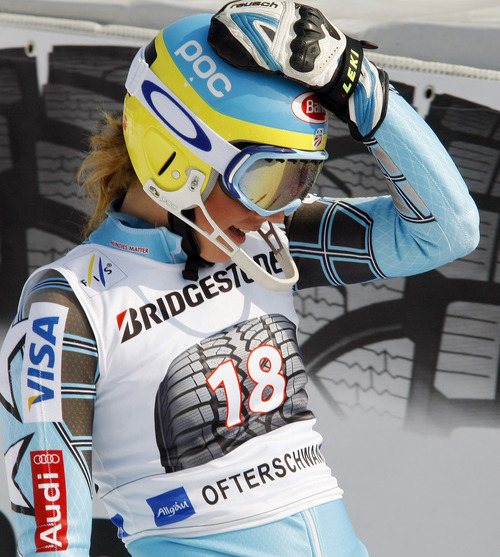 Mikaela Shiffrin, of the United States, stands in the finish area after completing the first run of an alpine ski, women's World Cup slalom, in Ofterschwang, Germany, Sunday, March 4, 2012. (AP Photo/Elvis Piazzi)