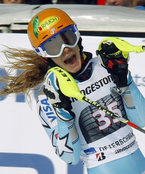Resi Stiegler, of the United States, celebrates her second place after completing an alpine ski, women's World Cup slalom, in Ofterschwang, Germany, Sunday, March 4, 2012. (AP Photo/Elvis Piazzi)