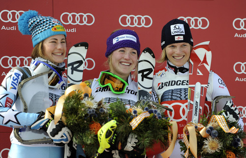 Erin Mielzynski, of Canada, center, winner of an alpine ski, women's World Cup slalom, smiles on the podium with second placed Resi Stiegler, of the United States, left, and third placed Marlies Schild, of Austria, in Ofterschwang, Germany, Sunday, March 4, 2012. (AP Photo/Elvis Piazzi)