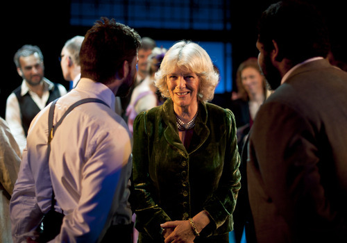 Britain's Camilla, The Duchess of Cornwall, centre, meets with unidentified prison inmates as she arrives at Erlestoke Prison to watch a performance of the stage show Les Miserables, to be performed by an Opera group and prison inmates, Directed by Pimlico Opera director Michael Moody, not pictured, in Devizes, England, Friday March 2, 2012. (AP Photo / Ben Birchall)