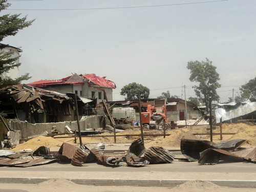 Debris from blast-damaged homes are seen in the Ouenze neighborhood after multiple explosions occurred at a munitions depot, in Brazzaville, Republic of Congo Sunday, March 4, 2012. Blasts rocked the capital of the Republic of Congo Sunday morning after a weapons depot caught fire, officials said, killing and wounding unknown numbers of people and forcing 2,000 to flee their homes.(AP Photo/Louis Okamba)