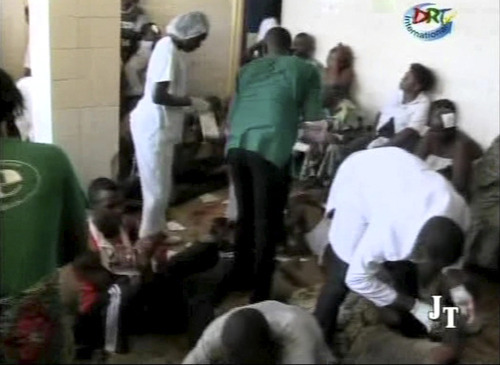 This video image made from DRTV shows injured people being assisted inside a hospital after blasts rocked Brazzaville, the capital of the Republic of Congo Sunday March 4, 2012 after a weapons depot caught fire.  Officials in the Congo said an unknown numbers of people were killed and wounded and some 2,000 people were forced to flee their homes. The explosions shook houses in Brazzaville and echoed across the Congo River to the capital of the neighboring country.   (AP Photo/DRTV)  REPUBLIC OF CONGO OUT