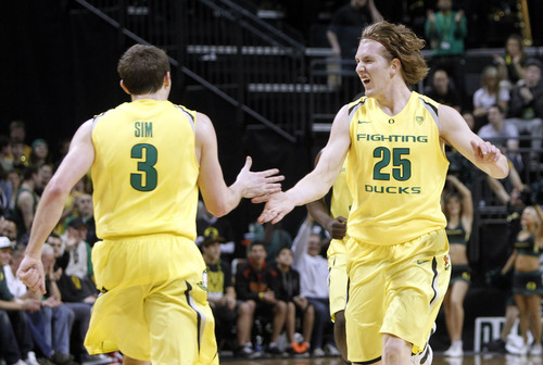 Oregon's Garrett Sim (3) is congratulated by teammate E.J. Singler (25) after sinking a 3-point shot during the first half of an NCAA college basketball game Saturday, March 3, 2012, in Eugene, Ore. (AP Photo/Chris Pietsch)