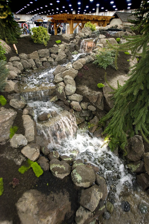 Paul Fraughton | The Salt Lake Tribune. A  waterfall feeds a  small stream meandering though a landscape at this year's Home and Garden Show at the South Towne Expo Center in Sandy.  Thursday, March 8, 2012