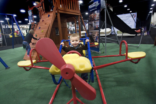 Paul Fraughton | The Salt Lake Tribune Carden Christensen, age 2, of Herriman, gets some play time in Thursday at the Lifetime Store display at this year's Salt Lake Tribune Home & Garden Festival that runs through Sunday at the South Towne Expo Center in Sandy.