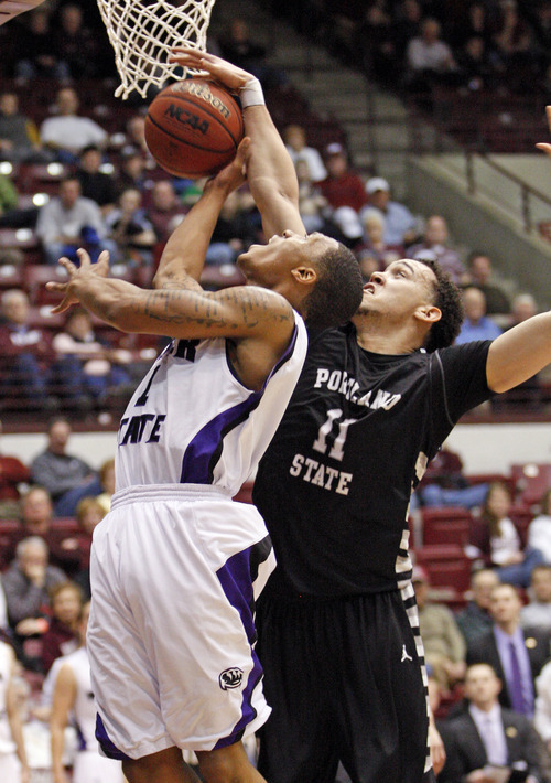 Weber State guard Damian Lillard (1) is fouled under the basket by Portland State forward Chehales Tapscott (11) during the second half of a Big Sky Tournament NCAA college basketball game in Missoula, Mont., on Tuesday, March 6, 2012.(AP Photo/ Michael Albans)