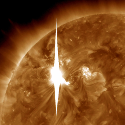This handout image provided by NASA shows a solar flare heading toward Earth. An impressive solar flare is heading toward Earth and could disrupt power grids, GPS and airplane flights. An impressive solar flare is heading toward Earth and could disrupt power grids, GPS and airplane flights. Forecasters at the National Oceanic and Atmospheric Administration's (NOAA) Space Weather Prediction Center said the sun erupted Tuesday evening and the effects should start smacking Earth late Wednesday night, close to midnight EST. They say it is the biggest in five years and growing. (AP Photo/NASA)