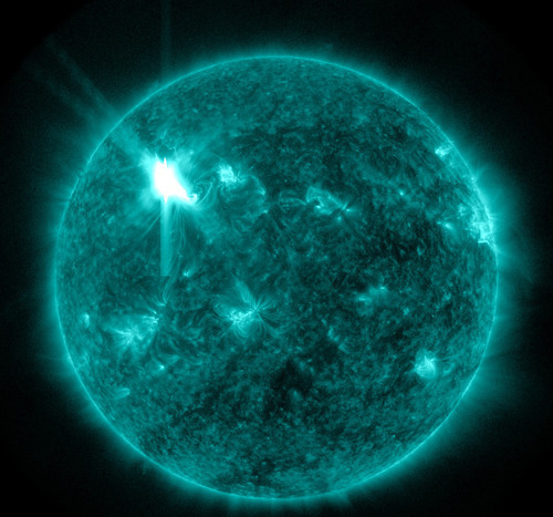 This extreme ultraviolet wavelength image provided by NASA shows a solar flare. An impressive solar flare is heading toward Earth and could disrupt power grids, GPS and airplane flights. An impressive solar flare is heading toward Earth and could disrupt power grids, GPS and airplane flights. Forecasters at the National Oceanic and Atmospheric Administration's (NOAA) Space Weather Prediction Center said the sun erupted Tuesday evening and the effects should start smacking Earth late Wednesday night, close to midnight EST. They say it is the biggest in five years and growing. (AP Photo/NASA)