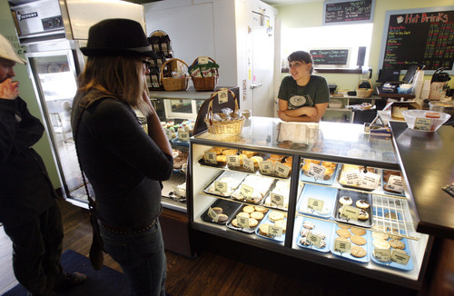 Francisco Kjolseth  |  The Salt Lake Tribune Emily Saunders at City Cakes Bakery waits for customers to order from vegan and gluten-free options.