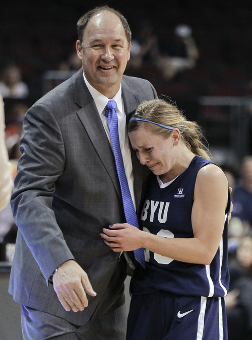 Brigham Young coach Jeff Judkins, left, greets guard Haley Steed as she leaves the court late in an NCAA college basketball game against Gonzaga for the West Coast Conference women's tournament title, Monday, March 5, 2012, in Las Vegas. Steed was named tournament MVP. BYU won 78-66. (AP Photo/Julie Jacobson)