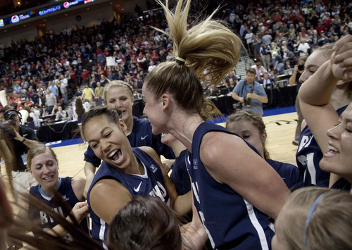 Brigham Young players celebrate after beating Gonzaga 78-66 during an NCAA college basketball game for the West Coast Conference tournament championship, Monday, March 5, 2012, in Las Vegas. (AP Photo/Julie Jacobson)