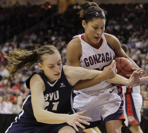 Gonzaga's Jazmine Redmon, right, strips BYU's Lexi Eaton of the ball in the second half during the NCAA West Coast Conference tournament championship basketball game, Monday, March 5, 2012, in Las Vegas. BYU won 78-66. (AP Photo/Julie Jacobson)