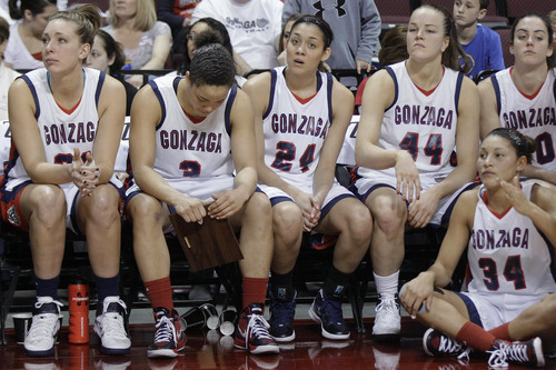 Gonzaga players watch from the bench after losing to BYU 78-66 in an NCAA college basketball game for the West Coast Conference women's tournament title, Monday, March 5, 2012, in Las Vegas.  (AP Photo/Julie Jacobson)
