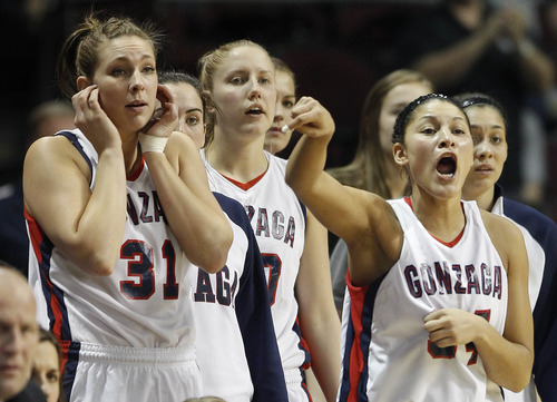 Gonzaga's Jazmine Redmon, right, shouts to teammates from the bench in the second half against BYU during the NCAA West Coast Conference tournament championship women's basketball game, Monday, March 5, 2012, in Las Vegas. BYU won 78-66. (AP Photo/Julie Jacobson)