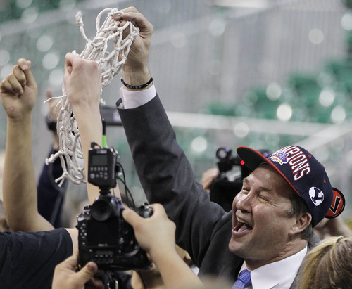 **CORRECTS TO JEFF JUDKINS** Brigham Young coach Jeff Judkins holds up the net after cutting it down following BYU's 78-66 win over Gonzaga in an NCAA college basketball game for the West Coast Conference women's tournament title, Monday, March 5, 2012, in Las Vegas. (AP Photo/Julie Jacobson)