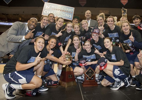 The Brigham Young team poses with the championship trophy after beating Gonzaga 78-66 in an NCAA college basketball game for the West Coast Conference women's tournament title, Monday, March 5, 2012, in Las Vegas. (AP Photo/Julie Jacobson)