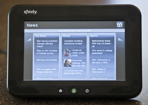 Chris Detrick  |  The Salt Lake Tribune Comcast has launched Xfinity Home, a security and monitoring service that provides protection against break-ins and also allows homeowners to control certain features in the house remotely. The system's in-home touch screen is pictured.