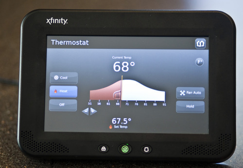 Chris Detrick  |  The Salt Lake Tribune Comcast has launched Xfinity Home, a security and monitoring service that provides protection against break-ins and also allows homeowners to control certain features in the house remotely. The system's in-home touch screendisplaying the temperature control is pictured.
