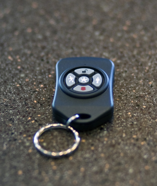 Chris Detrick  |  The Salt Lake Tribune Comcast has launched Xfinity Home, a security and monitoring service that provides protection against break-ins and also allows homeowners to control certain features in the house remotely. The system's key chain controller is pictured.