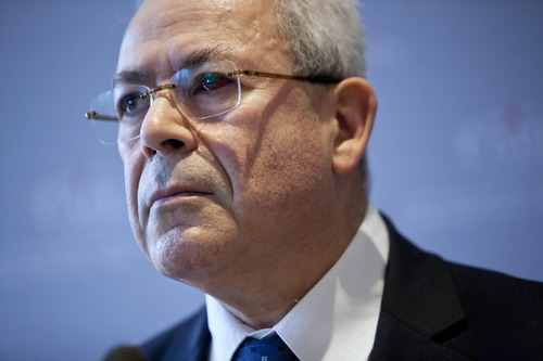 FILE - In a March 1, 2012 file photo Syrian National Council leader Burhan Ghalioun attends a news conference in Paris.  Ghalioun Friday March 9, 2012  rejected calls by former U.N. chief Kofi Annan for dialogue between the government in Damascus and the opposition, describing them as unrealistic.  (AP Photo/Thibault Camus/file)