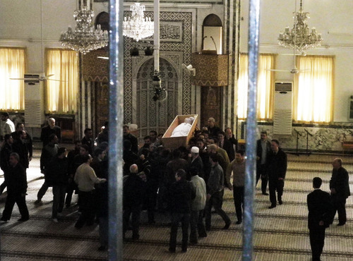 Mourners who oppose the regime of Syrian President Bashir Assad carry the body of Muhannad al-Malla inside a mosque during his funeral in the upscale neighborhood of Mazzeh, in Damascus, Syria, Thursday, March 8, 2012. Syrian security forces soon opened fire to disperse the crowd gathered for the funeral of al-Malla, a soldier who was allegedly executed in February in Homs for refusing to obey orders to shoot at civilians there. The violence at the funeral Thursday came shortly after U.N. humanitarian chief Valerie Amos had spoken in Damascus about her visit to Homs the day before, where she said she was struck by the devastation she saw. (AP Photo)