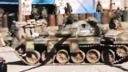 This image made from amateur video and released by Shaam News Network Thursday, March 8, 2012, purports to show a Syrian military tank in Homs, Syria. Kofi Annan, who has been appointed joint U.N.-Arab League envoy to Syria, said his mission was to start a
