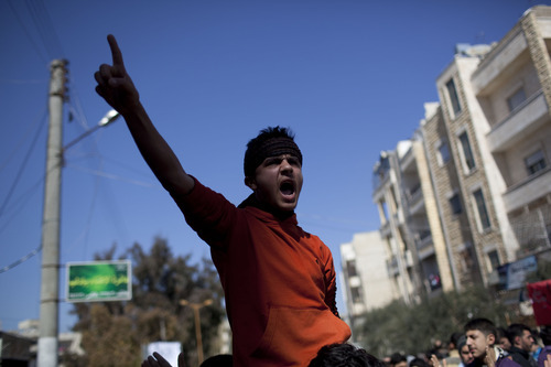 A man chants anti-government slogans during a demonstration in Idlib, north Syria, Friday, March 9, 2012. (AP Photo/Rodrigo Abd)