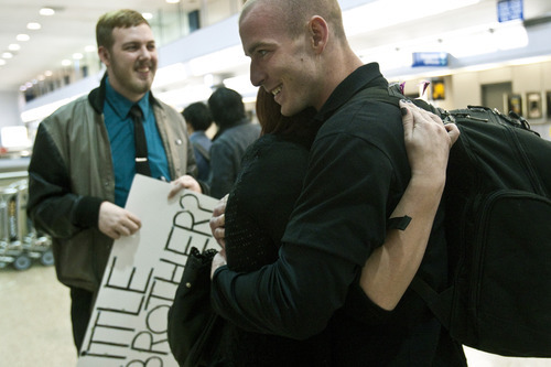 Chris Detrick  |  The Salt Lake Tribune Stephanie Cook and her brother Thomas Linton hug after meeting for the first time at the Salt Lake City International Airport Thursday March 8, 2012. Stephanie Cook was 1-year-old when her mother Bobbi Ann Campbell gave birth to a boy. Days later, Bobbi placed the boy for adoption. Four years later, Bobbi disappeared and police have yet to resolve what happened to her. Stephanie, 22, was raised by her great-grandparents, while her brother grew up in Mapleton. When she was a teenager, she came across infant photos of her brother, whom she knew was named Thomas. She always thought he grew up in Seattle. But in January she randomly googled